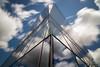 Torre de cristal (Csanz14) Tags: madrid spain españa torre edificio reflejo nubes larga exposicion movimiento cristal cielo rascacielos building nd1000 tokina 1116 nikon d3100 azul blue