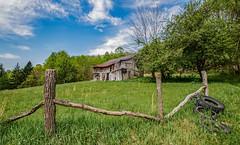 Keeney Mountain Barn_Color (Bob G. Bell) Tags: barn abandoned keeneymountain summers xt1 bobbell fujifilm sky clouds fence tires green wv westvirginia