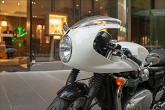 melbourne-3792-ps-w (pw-pix) Tags: motorcycle motorbike bike triumph thruxton sporty caferacer british white bikinifairing retro footpath shop lights displays man gawking staring looking suit green clock glowing 200 200pm twooclock 2oclock door windows reflections shiny autumn cold dull dark gloomy collinsstreet cbd melbourne victoria australia peterwilliams pwpix wwwpwpixstudio pwpixstudio