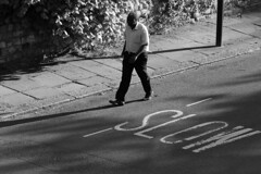 _MG_6320 (JetBlakInk) Tags: afro lowkey magichour men mono sniper streetphotography snipersniper highvantagepoint afrocaribbean walkingthewalk slowlane shadowyfigure composition subjecttoground
