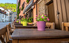 Authentic (✦ Erdinc Ulas Photography ✦) Tags: luxembourg vianden street authentic building plant plants panasonic focus detail chair table wood green purple flower road cafe centre stone door old traditional trees blue sky bricks window bar signs travel town