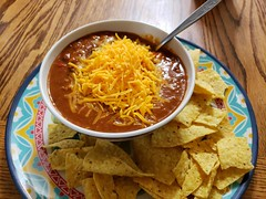 chili with shredded cheddar and nacho chips (jeffreyw) Tags: chili beans chips cheese cheddar lunch dinner roastedpoblanos redbellpeppers