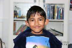 Ryan (ZH-Photography) Tags: ryan portrait indian asian boy child smiling casual home book happy