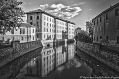 Cityscape with Lambro river