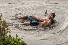 Down by the Sea, Chorillos (Geraint Rowland Photography) Tags: candid fotografia chorillos lima peru wwwgeraintrowlandcouk children swimming ocean lake river mud childrenplaying peruvians canon streetphotography geraintrowlandphotography