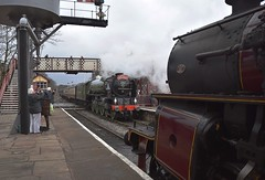 A1 Peppercorn Steam Locomotive No.60163 'Tornado' makes a non-stop pass through Ramsbottom, enroute to Heywood from Rawtenstall, as LMS Crab loco No. 13065 waits for the road. East Lancs Railway, 31 03 2018 (pnb511) Tags: team engine loco locomotive train track station platform people canopy engines locos locomotives trains signals semaphores gantry smoke 462 pacific eastlancsrailway