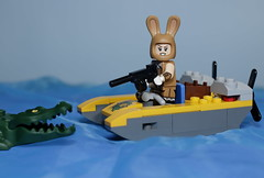 Bunny has decided to do some alligator hunting in her new boat (N.the.Kudzu) Tags: tabletop lego minifigures alligator bunny boat primelens manualfocus canondslr lensbabyburnside35
