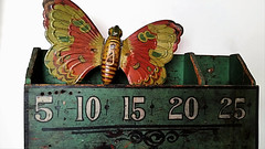 Butterfly stuck in Box, since the 1800's (change is good if it's for better) Tags: butterfly tin wooden box numbers antique green chein butterflyinbox samsung vintage toy tintoy butterflywings orange red number 5 10 15 20 25 wings old store wood sign holes