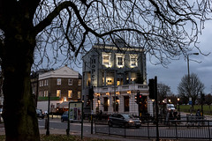 December Hope London (armct) Tags: 28300mm d810 nikon deciduous tree welcome warmth unitedkingdom balham wandsworthcommon streetscape refuge dusk nightlights silhouette common parkland park intersection tavern hotel winter london