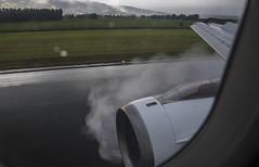 Full reverse thrust! (Ian@NZFlickr) Tags: jet landing after rain spray reverse thrust dunedin international airport otago nz