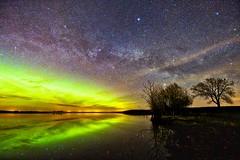 Spring Night Sky (John Andersen (JPAndersen images)) Tags: alberta aurora milkyway reflections smoke stars strathmore trees