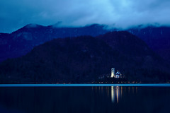 Church in Lake Bled (saknopper) Tags: church lake bled slovenia water reflection mountains clouds lights