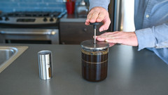 From best manual coffee grinder to french press brewing morning cup of java (yourbestdigs) Tags: coffee grinder grinds grounds manual java javapress javapresse french press frenchpress man hands hand kitchen counter grey gray stainless steel glass push sink morning sun sunlight