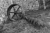 IMG_3968 (foregorp) Tags: bethlehem lehighvalley pennsylvania outside wheel grass blackandwhite bw spokes metal stone wall