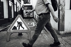 IMG_7340 (JetBlakInk) Tags: subjecttoground subjecttoback streetphotography mono signage roadsign footfall composition men mens health overweight