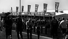 Merchandise .. British Superbikes (Missy Jussy) Tags: merchandise shopping sale advertising promotional britishsuperbikes oultonpark canon 70200mm ef70200mmf4lusm ef70200mm canon70200mm 5d canon5dmarkll canon5d canoneos5dmarkii mono monochrome bw blackwhite blackandwhite sunlight flag people event