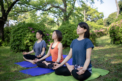 Three women practicing yoga in public park (Apricot Cafe) Tags: img90714 adultsonly asia asianandindianethnicities exercisemat healthylifestyle japan japaneseethnicity odaibatokyo relaxationexercise tamronsp35mmf18divcusdmodelf012 tokyojapan athlete beautifulwoman breathing capitalcities concentration copyspace crosslegged day exercise eyesclosed flexibility friendship fulllength greencolor happiness lifestyles