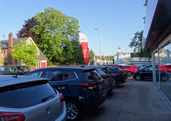 Kome and buy our Kia kars... (stevenbrandist) Tags: loughboroughkia kia cars forecourt mountsorrel leicestershire morning commute commuting flag