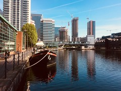 """Millwall Inner Dock London. (Bennydorm) Tags: city """"isleofdogs"""" iphone5s sunny sky blue reflections barge inglaterra inghilterra angleterre europe uk gb britain england architecture buildings london millwall dock water"""