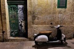 Strait Street Scribbles (Douguerreotype) Tags: scooter door dark urban malta art street streetart city valletta graffiti night moped wall bike