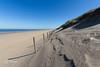 Dunes, beach, sea and a row of poles. (Leo Kramp) Tags: 2018 dunes amsterdamsewaterleidingduinen duinen wandelen loweproflipside300awii zee beach accessoires strand paaltjes sea noordwijk zuidholland nederland nl flickr