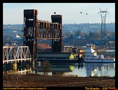 wed115g (funnelfan) Tags: train railroad railway shortline locomotive pnw pacificnorthwest idaho watco clearwater river lift bridge barge tug waiting lewiston