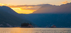Sunset in the Bay of Kotor (yuriye) Tags: perast montenegro winter water sea gulf reflection church mountain kotor пераст черногория залив town silence fjord yuriye boat sky yuryelysee sunset island gospa monastery остров горы beauty landscape crna gora госпа од шкрпела святого георгия sveti đorđe saint george benedictine our lady rocks light mountainside coast adriatic