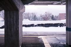 Pause (OzGFK) Tags: 35mm akakuraonsen asia fujiindustrial100 honshu japan myokokogen nikkor nikon analog cold film skiing snow snowboarding travel winter wintersports trainstation japanrail jr train transit transport publictransport platform trainplatform