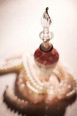 Perfume and pearls (alideniese) Tags: 7dwf crazytuesdaytheme perfume perfumebottle stilllife bokeh pearls bottle glass delicate focus alideniese shallowdepthoffield texture jewellery necklace shiny bright light egyptianperfumebottle egyptian souvenir closeup