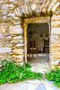 Looking through Open Doors (George Plakides) Tags: mani vathia towerhouse door stone masonry chairs traditional