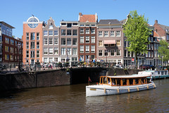 Amsterdam in one picture (gooey_lewy) Tags: amsterdam holland netherlands weekend away travel with friends canal boat buildings anne frank house opposite bike bicycle river water street people one photo