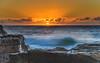 Bold Orange Sunrise Seascape (Merrillie) Tags: daybreak sunrise northavoca nature water rocks centralcoast morning newsouthwales waves earlymorning nsw sea avocabeach ocean rocky landscape northavocabeach coastal waterscape sky seascape australia coast dawn outdoors