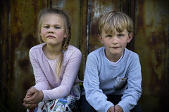 Famke & Oskar (' A r t ') Tags: girl boy pose portrait though stare whats up child children contrast shed natural light
