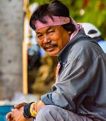 Bandana headband, in pink (Robica Photography) Tags: thailand bangkok daytime sunny man headband pink street sitting portrait d3200 streetphotography robicaphotography art streetart