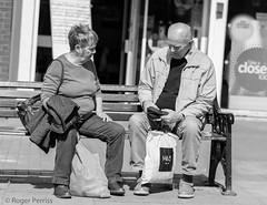 VISITORS, TAMWORTH, STAFFS_DSC_8600_LR_2.5 (Roger Perriss) Tags: peopleinpublic tamworth bencj balckandwhite sitting seating talking bags towncentre citycentre