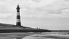lighthouse in bw (keriarpi) Tags: lighthouse hollandia breskens panorama beach sea spring pano beacon cloud sky road grass moment bw black white
