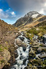 Tryfan and Ogwen Falls (Adrian Evans Photography) Tags: stone welshlandscape d850 snowdonia landscape ogwenfalls nikon longexposure ogwen glyderaumountains mountain outdoor tryfanmountain uk riverside clouds ogwenvalley wales creek river rapids waterfall carneddaumountains adrianevans northwales tryfan sky winter snowdonianationalpark landmark water valley