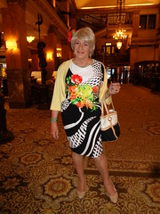 Another Blatant Attempt To Be The Center Of Attention (Laurette Victoria) Tags: lobby hotel milwaukee pfisterhotel dress floralprint purse pumps blonde woman laurette