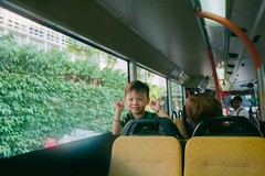kid smile on my cam #35mmfilm (31lucass shots) Tags: minolta strangers kid snapshot singaporeimages singapore 28mmrokkor minoltax700 kodakultramax400 kodak filmphotography analoguefilm negativefilm 135film 35mmfilm