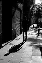 I Come in Peace 👽 (sawyersource) Tags: barcelona catalonia spain españa catalunya streetphotography people shadow alien hardlight lowiso highcontrast bw blackandwhite streetlife d7200 35mmlens nikon nikkor man castshadow silhouette keyline backlight bnwphotography bnwstreet