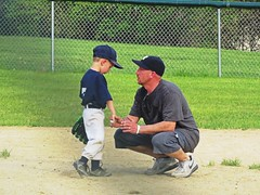 As a father I enjoy getting my son and grandson in a scene like this. (kennethkonica) Tags: littleleague sports hats people persons canonpowershot canon indianapolis indiana indy usa midwest america hoosiers boysofsummer games uniforms random faces kids child mood family fun action yankees fence outdoor