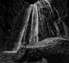 Gljúfrabúi Falls (p.g604) Tags: 20180424imgp2292editedit2 nearly hidden waterfall narrow canyon that cascades pool near seljalandsfoss get a bit wet iceland bw blackwhite wideangle pentax k1 person rocks cliffs water droplets splash streams
