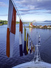 Coloured cranes in Tahiti (Tony Tomlin) Tags: tahiti southpacific papeete port cranes flags bow