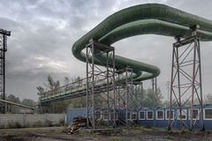 Haze at the end of the day (Markus Lehr) Tags: haze pipes tubes uturn scaffolding scrap green blue container wall industrial textures highvoltagepylons trees manmadelandscape urbanspace heatingplant karviná czechrepublic markuslehr