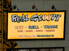 Real Groovy (Remixed) (Steve Taylor (Photography)) Tags: realgroovy buy sell trade cds dvds vinyl games 178tuamst notes music digitalart sign shop wall grey yellow brown black newzealand nz southisland canterbury christchurch cbd city cartoon