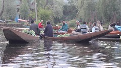 The first boats of the morning (Nagarjun) Tags: floatingvegetablemarket flowers dallake kashmir srinagar commerce trade veggies kohlrabi dawn morning sunrise green
