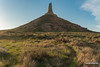Path To Chimney Rock (kevin-palmer) Tags: chimneyrock chimneyrocknationalhistoricsite bayard nebraska may spring oregontrail evening sunny sunlight gold golden clouds blue sky green grass sagebrush trail path tower pillar rockformation nikond750 tamron2470mmf28 spire