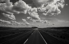 sometimes the best view is the one straight ahead... (Alvin Harp) Tags: may 2018 us395 washingtonstate ritzville pasco vanishingpoint cloudsstormssunsetssunrises highway greatclouds billowyclouds cumulusclouds sonyilce7rm3 fe2470mmf28gm roadshot blackandwhite mono bwclouds bw alvinharp