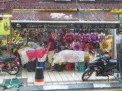 Monsoon I (m_artijn) Tags: rain monsoon flower shop store shelter kuala lumpur mys bored