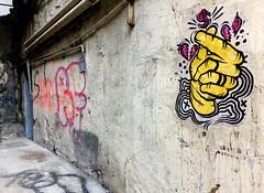 Fingersnap (cowyeow) Tags: china street chinese asia asian 香港 hongkong sheungwan city urban composition graffiti wall streetart odd weird funnyhongkong painting art ally hands yellow snap door